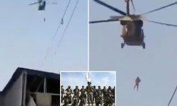 (VIDEO) TERIFIANT! Talibanii s-au plimbat cu elicopterele americane Black Hawk. Corpul unui bărbat, agățat de aeronavă